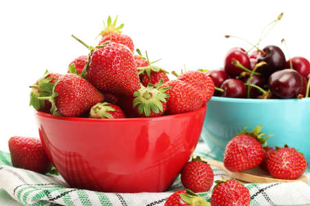 Ripe strawberries and cherry berries in bowls isolated on white Stock Photo - 13874606