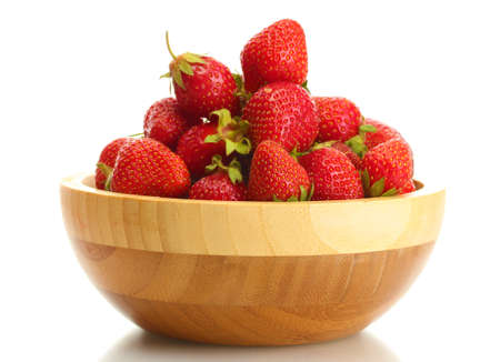 sweet ripe strawberries in wooden bowl isolated on white photo