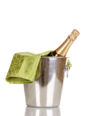 Bottle of champagne in bucket isolated on white photo
