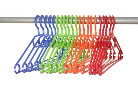 plastic hangers in row  isolated on white photo
