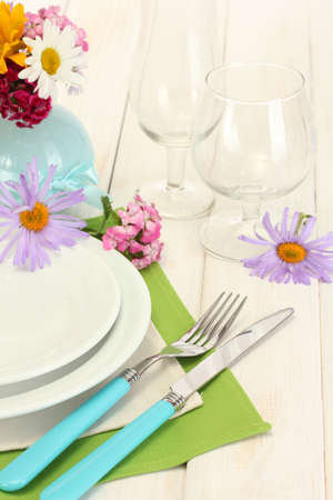 beautiful holiday table setting with flowers photo