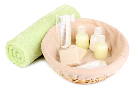 Hotel amenities kit in basket isolated on white photo