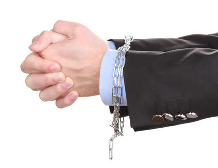 Businessman hands fettered with chain isolated on white photo