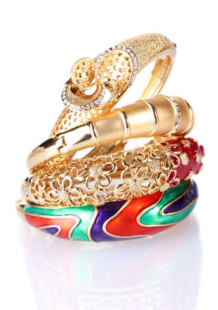 Beautiful golden bracelets isolated on white photo