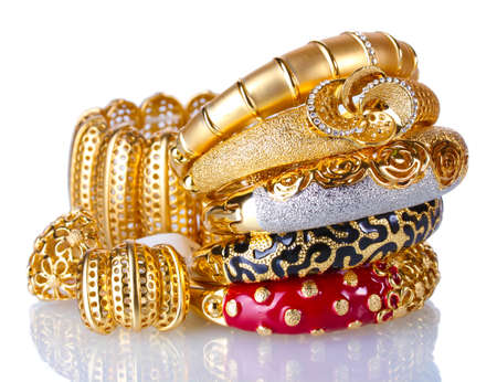 fashion jewelry: Beautiful golden bracelets isolated on white