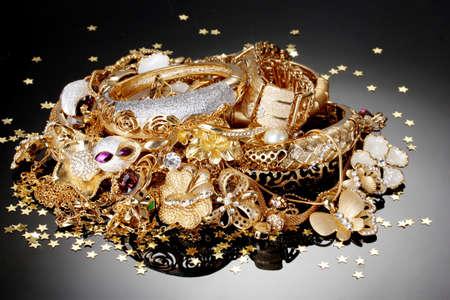 Beautiful golden jewelry on grey background Stock Photo