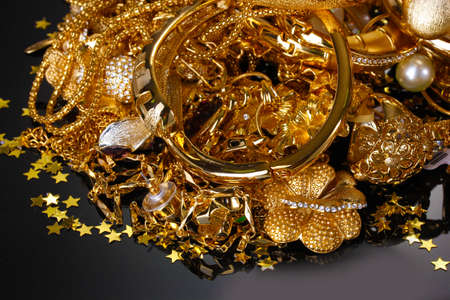 Beautiful golden jewelry on grey background photo