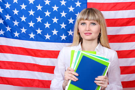 Young woman on the background of the flag of America photo