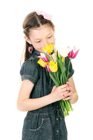 resent: Portrait of beautiful little girl with tulips isolated on white