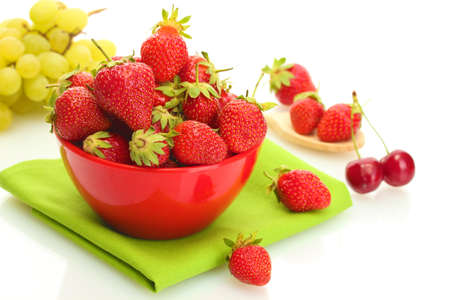 sweet ripe strawberries in bowl and grapes isolated on white Stock Photo - 13949688