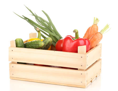 Fresh vegetables in crate isolated on white photo