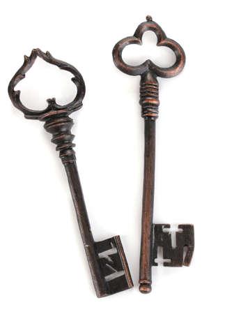 Two antique keys isolated on white Stock Photo - 13947646