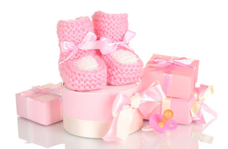 pink baby boots,  pacifier and gifts isolated on white Stock Photo - 13948699
