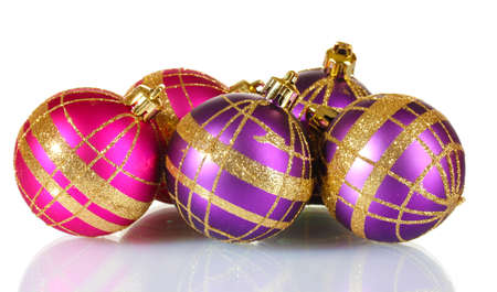 beautiful purple and pink Christmas balls isolated on white