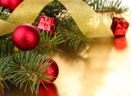 Christmas tree with beautiful New Year's balls and ribbon on table Stock Photo - 14135102