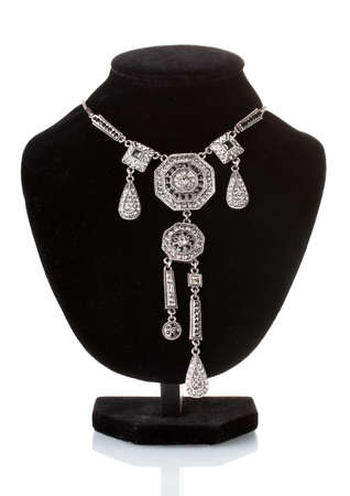 jewelle: Silver necklace on black mannequin isolated on white