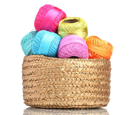 basket embroidery: Bright threads for knitting in the basket isolated on white Editorial