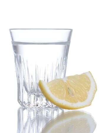 Glass of vodka with lemon isolated on white