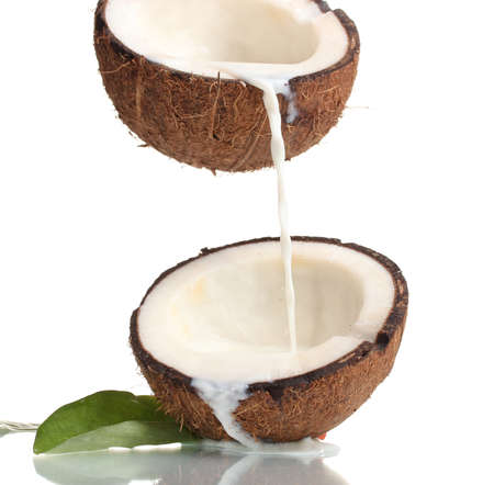 with coconut: Coconut with coconut milk isolated on white Editorial