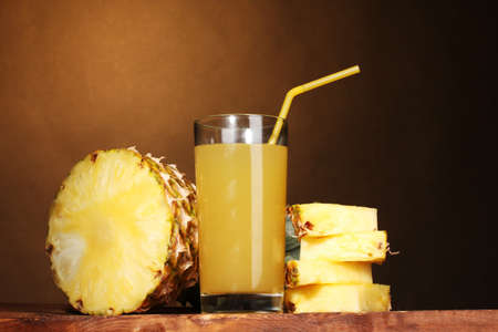 Рineapple juice and pineapple on brown Stock Photo - 14135098