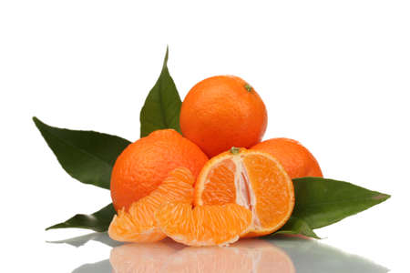 Ripe tasty tangerines with leaves and segments isolated on white Stock Photo - 14134856