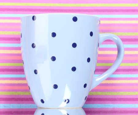 Ð¡olor cup on color background