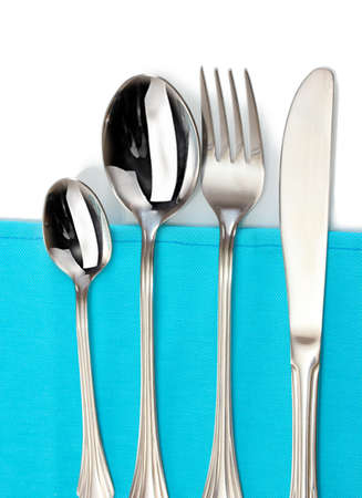 Fork, spoon and knife on a blue tablecloth