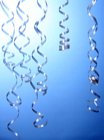 beautiful streamers on blue background Stock Photo - 14135027