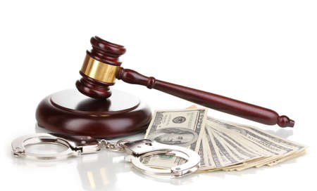 Dollar banknotes, handcuffs and judges gavel isolated on white