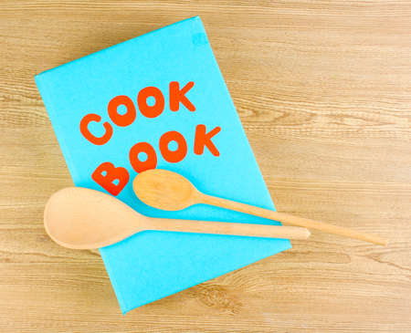 Cookbook and kitchenware on wooden background Stock Photo - 14135109