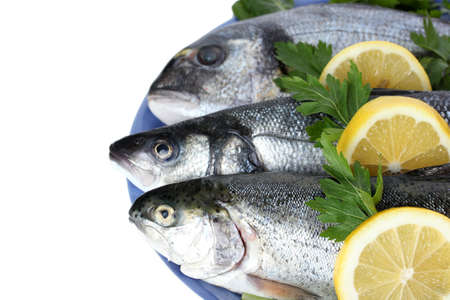 Fresh fishes with lemon and parsley on plate isolated on white Stock Photo - 14135106