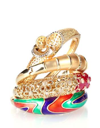 diamond jewellery: Beautiful golden bracelets isolated on white