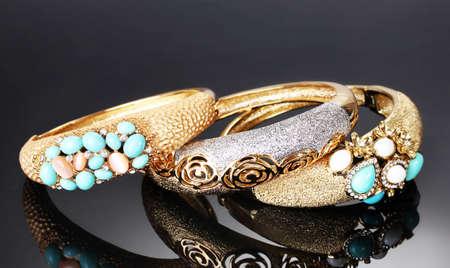 Beautiful golden bracelets on grey background Stock Photo - 14135083