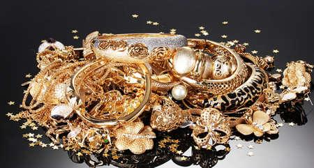 Beautiful golden jewelry on grey background Stock Photo - 14135161