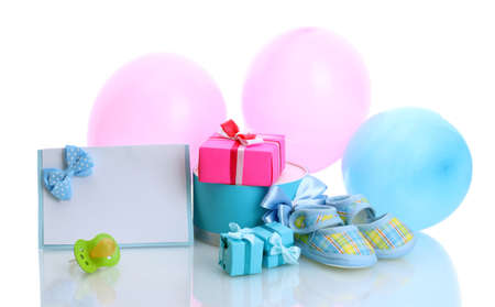 beautiful gifts, babys bootees, blank postcard, dummy and balloons isolated on white