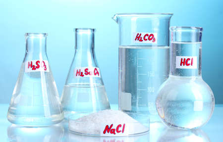 Test-tubes with various acids and chemicals  on blue background Stock Photo - 14135063