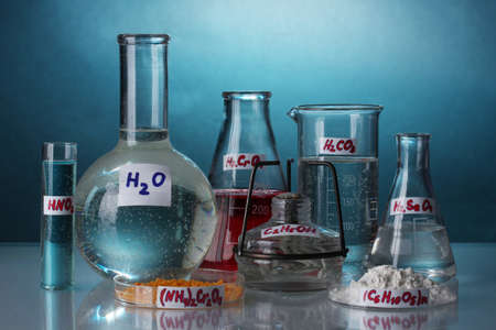 Test-tubes with various acids and chemicals  on bright background