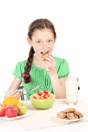 have: little beautiful girl have a breakfast on white background Stock Photo