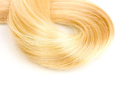 Shiny blond hair isollated on white photo