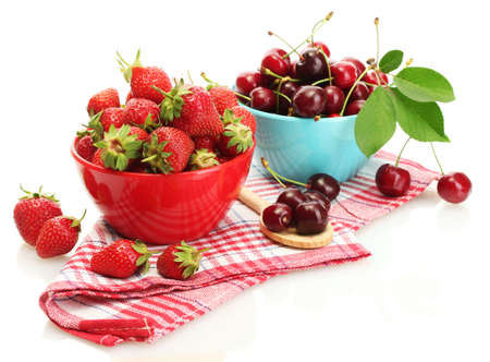 Ripe strawberries and cherry berries in bowls isolated on white Stock Photo - 13978583