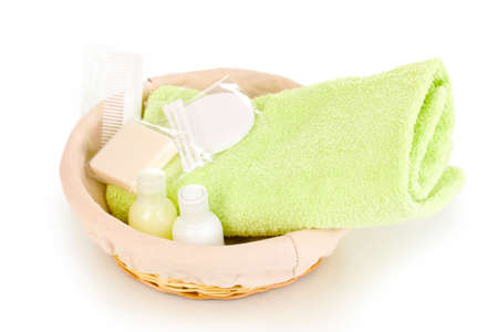 Hotel amenities kit in basket isolated on white Stock Photo - 13978568