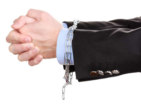Businessman hands fettered with chain isolated on white Stock Photo - 13978522