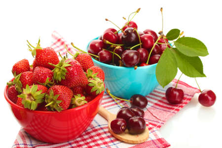 Ripe strawberries and cherry berries in bowls isolated on white photo