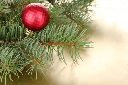 Christmas tree with beautiful New Years ball on table photo