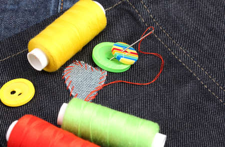 Heart-shaped patch on jeans with threads and buttons closeup Stock Photo - 13994650