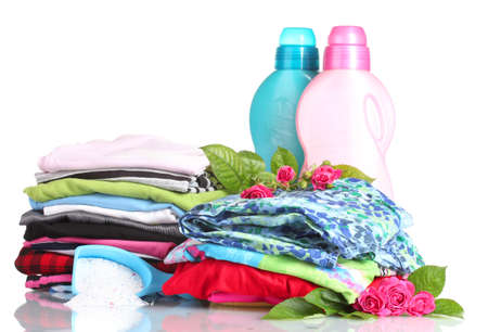 Detergent with washing powder and pile of colorful clothes isolated on white Stock Photo - 13994347