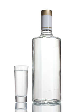 vodka: Bottle of vodka and wineglass isolated on white