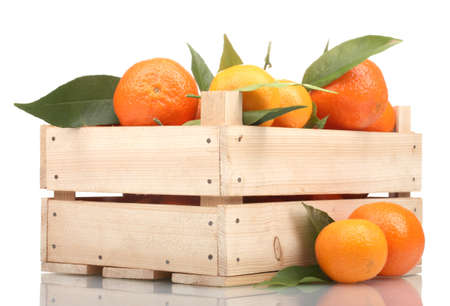 Ripe tasty tangerines with leaves in wooden box isolated on white photo
