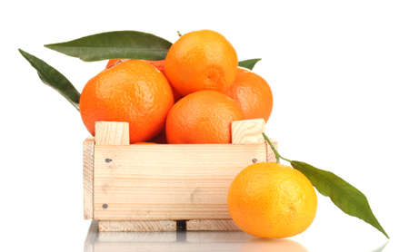 Ripe tasty tangerines with leaves in wooden box isolated on white Stock Photo - 13993598