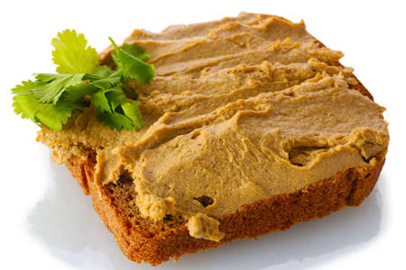 Fresh pate on bread isolated on white Stock Photo - 13994608